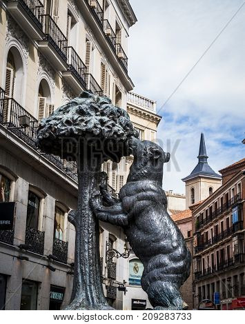 Madrid April 2009 Spain: symbol of Madrid statue of bear and strawberry tree puerta del sol Spain, The statue has a plate that says it is geographically located in the center of Spain