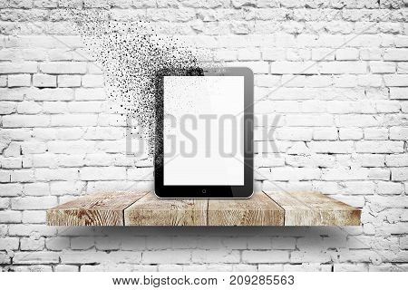 3d illustration of Tablet pc disintegration on wooden shelf over white brick background