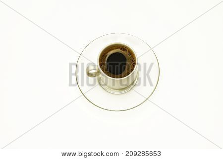 A cup of coffee on a glass transparent saucer on a white background