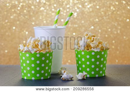 christmas movie with popcorn and drink in paper cup, gold background