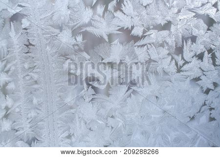 Winter Background. Frosty Pattern On Window Pane With Strips And Big Snowflakes.