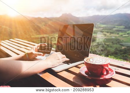 Work Life Balance. Business Man Using Laptop Computer And Credit Card For Online Financial With A Cu