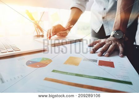 Close Up Image Of Analysis Business Accounting On Info Sheets. Businessman Hand Working On Analyzing