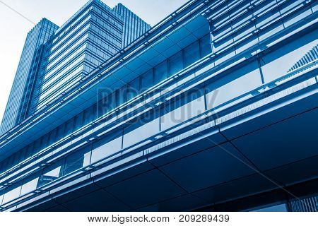 modern office buildings exterior,detail shot,blue toned,shanghai,china.