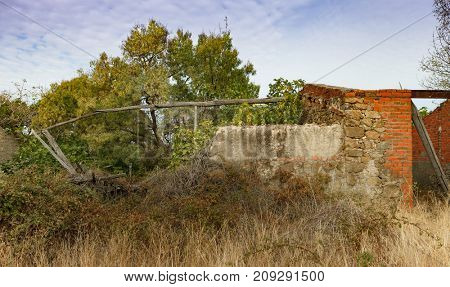 Destroyed house in the countryside and with wild vegetation
