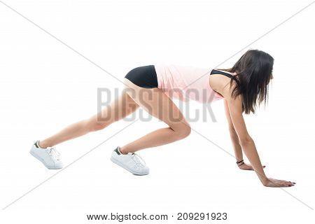 Full Body Of Fit Girl Exercising Wearing Shorts