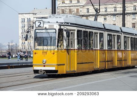 Typical yellow tram in the city of Budapest