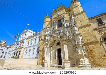 Santa Cruz Monastery and Church and Town Hall of Coimbra in Praca 8 de Maio, sunny day with blue sky. Central Portugal, Europe.