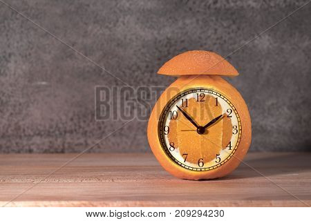 Alarm Clock made of orange fruit orange fruit background. Fruit skin texture