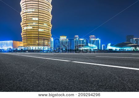 empty highway travel through modern skyscrapers,China.