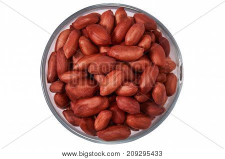Peanuts in a glass bowl on a white background isolate.