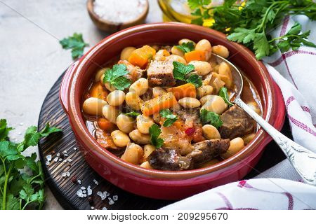 Beef stew with beans and vegetables. Chili con carne.
