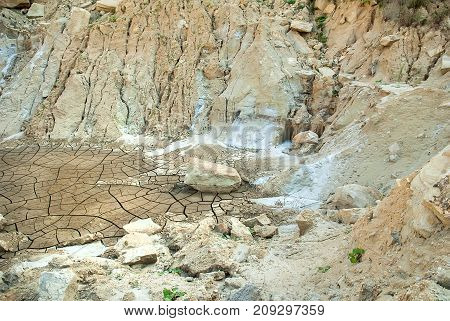 Cracks on the parched earth at the bottom of the dried-up lake