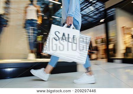 Modern shopper rushing for hot black friday sale in modern mall