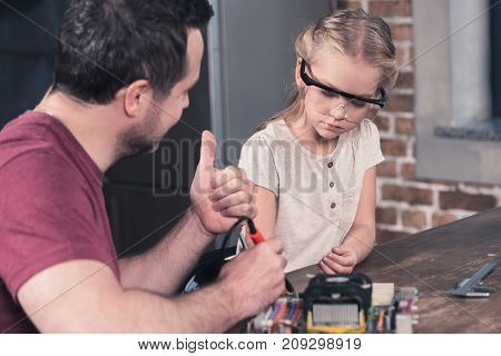 Father Showing Thumb Up To Daughter