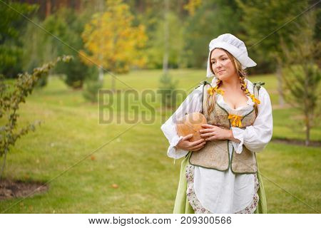 peasant woman with a pumpkin in the background of a nature