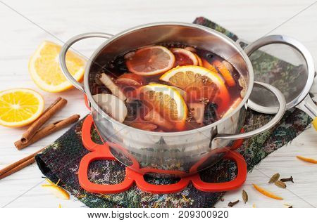 Cooked Mulled Wine In A Saucepan With Orange And Cinnamon