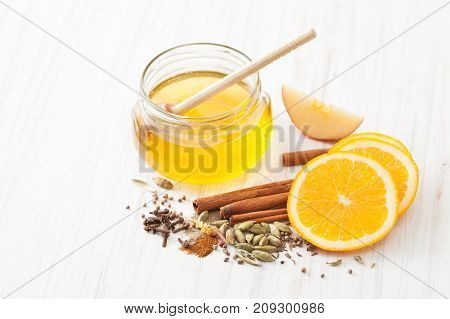 Honey And Spices For Mulled Wine On White Kitchen Table
