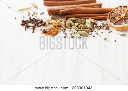 Spices For Mulled Wine Loose On White Wooden Table