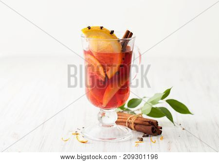 Mulled Wine In Glass Goblet With A Slice Of Orange With Cloves And Cinnamon