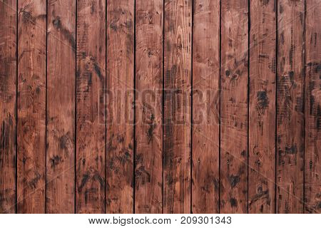 Brown, wooden board fence. Dark vintage wooden boards. Backgrounds and textures fence painted. Front view. Attract beautiful vintage. burnt boards