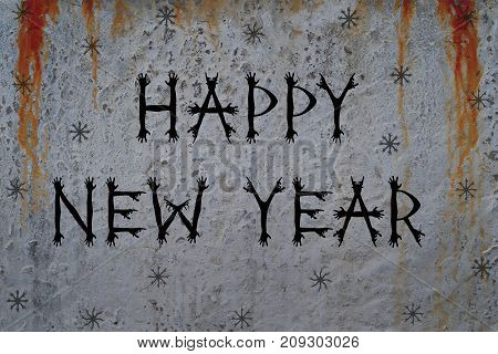 Inscription HAPPY NEW YEAR and snowflakes on bloody cement wall background. Creative font made from zombie hand silhouettes. Concept for greeting or invitation card.
