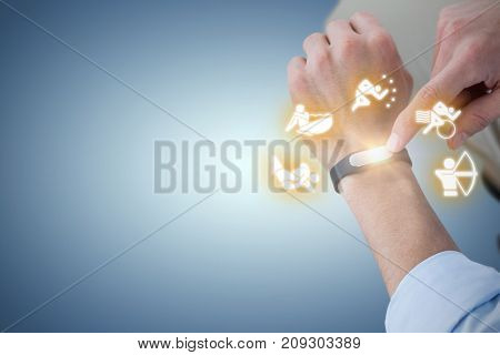 Midsection of man using smart watch against purple vignette