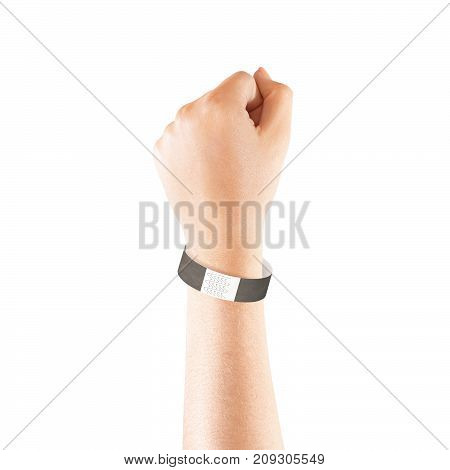 Blank black paper wristband mock up on persons arm. Empty event wrist band design mockup on hand. Cheap bracelets template, isolated. Clear adhesive bangle wristlet with sticker. Concert armlet