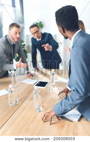 multiethnic businesspeople having conversation at conference hall