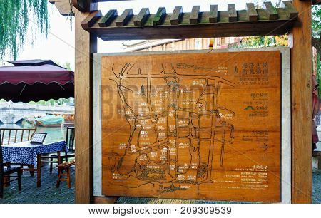 Suzhou, China - Nov 5, 2016: Tourists or visitors information directory board at the ancient Zhouzhuang Water City. A very popular destination.