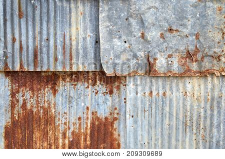 Overlapping rusty corrugated zinc sheets texture background