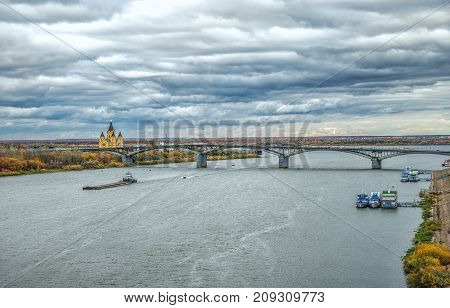 View of river Oka in Nizhny Novgorod, Russia with banks and cathedral of St. Alexander Nevskiy on background during golden autumn