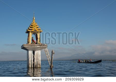 Tourist travel by local boat to visit the floating village of Intha people in Inle lake of Shan state of Myanmar-18 december 2016