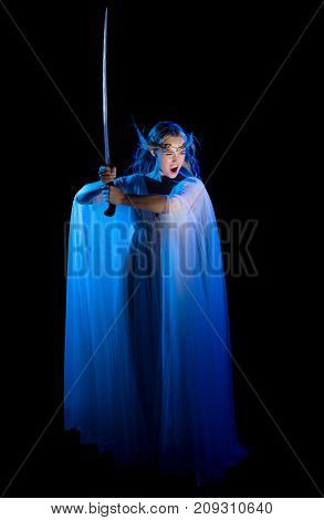 Young elven woman isolated on black poster