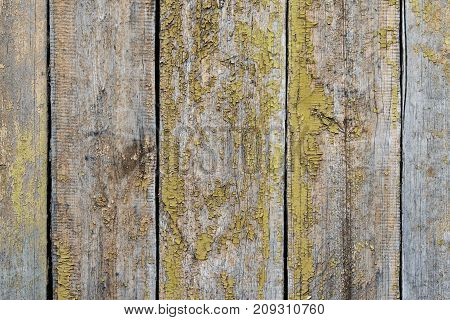 Old shabby wooden background with cracked paint. Wooden texture with scratches and cracks