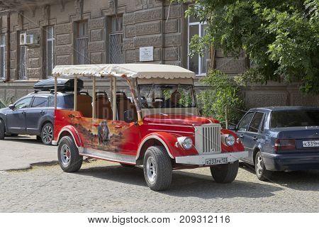 Evpatoria, Republic of Crimea, Russia - July 19, 2017: Excursion retro car on the basis of GAZ-69 near the house of Semyon Ezrovich Duvan in Evpatoria