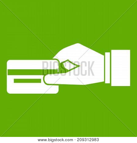 Hand holding a credit card icon white isolated on green background. Vector illustration