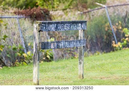 Fairhaven Massachusetts USA - October 12 2017: Message on old wooden fence along Phoenix Bike Trail:
