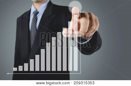 Double exposure businessman writing growing stock market index graph. Financial stock market in accounting market economy analysis.