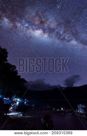 Milky Way landscape. Clearly Milky way above Lake Segara Anak inside crater of Rinjani mountain on night sky. Lombok island Indonesia.
