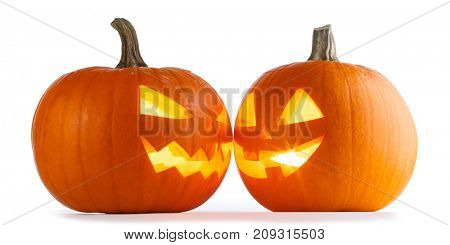Two Halloween Pumpkins looking to each other isolated on white background