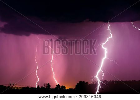 Lightnings And Storm Over Forest At Night. Thunder
