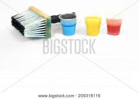 Big and small paintbrushes and blue, yellow and red stains - top mock up