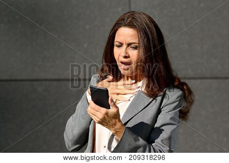 Shocked Middle Aged Woman Reading A Text Message