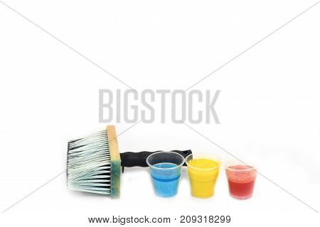 Big paintbrush and blue, yellow and red stains - bottom mock up