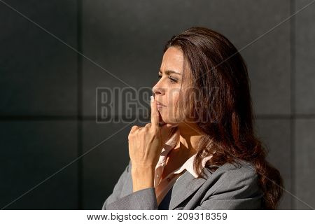 Thoughtful Woman Standing Musing A Problem