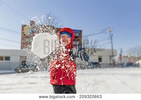 boy throws snowballs. winter fun outdoors. copy space for your text poster