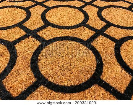 Pattern of coconut shell fiber dust mat with black geometry shape