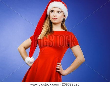 Xmas seasonal clothing winter christmas concept. Young neutral confident woman wearing Santa Claus helper costume