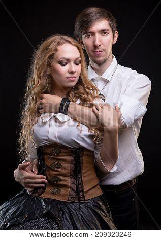 Hugging gentle loving couple on black background